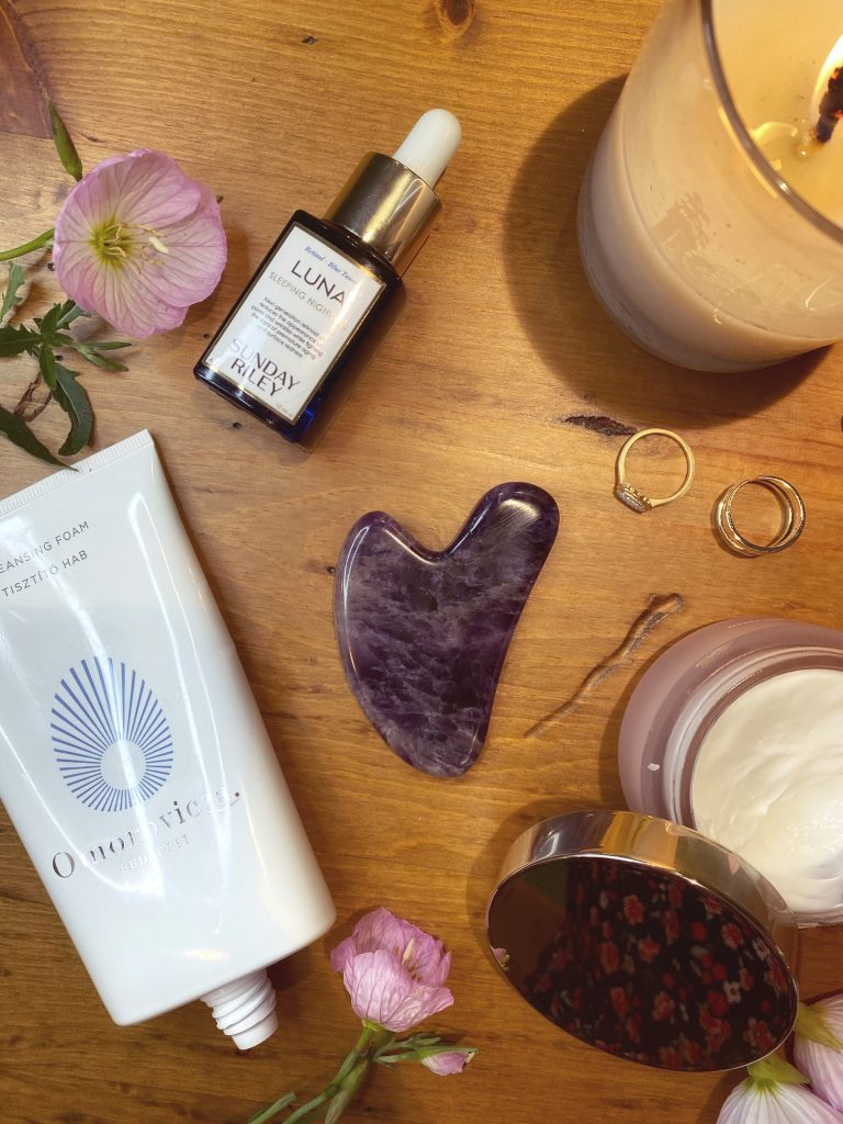 Flatlay of gua sha with beauty products