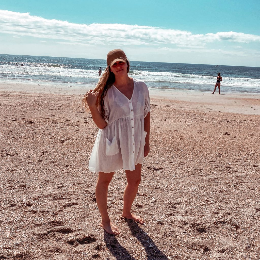white cover up on beach